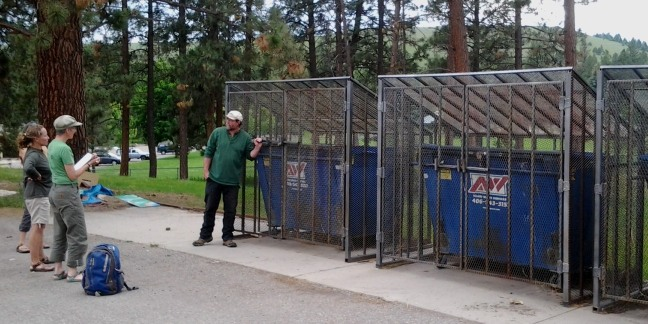 Bear-resistant dumpster cages at Rattlesnake Middle School.